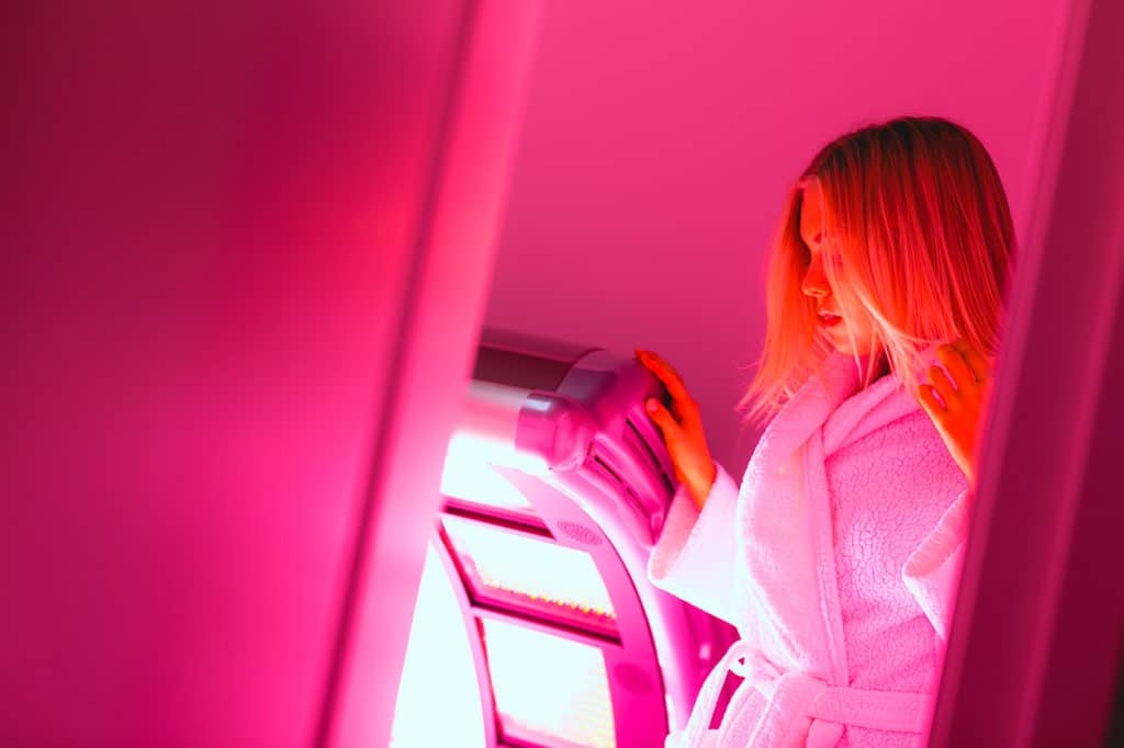 woman getting ready for red light therapy at LuxCryo in Portland