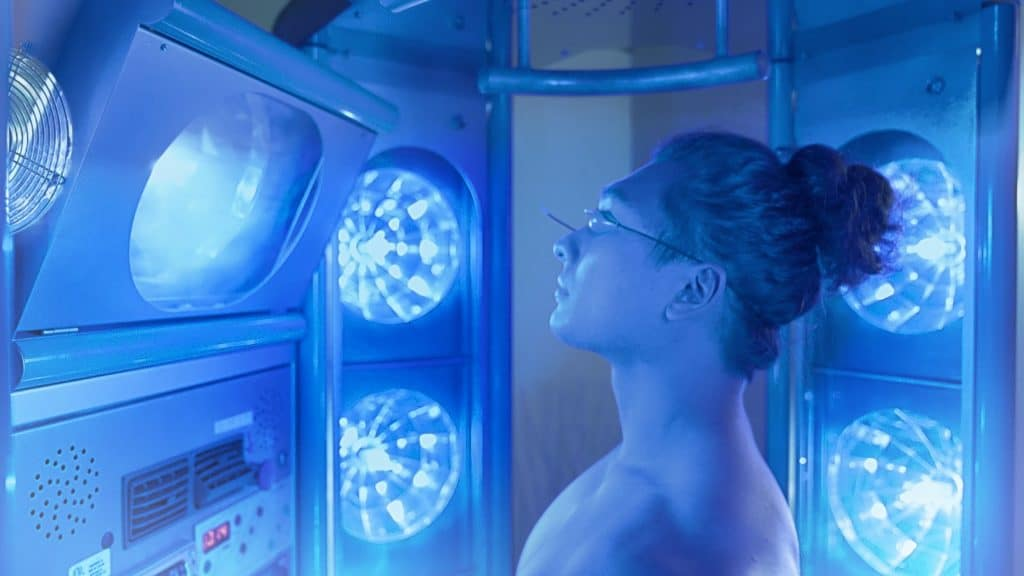 Man recieving UV Tanning treatment