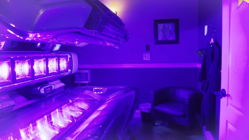 Therapy room with open tanning bed