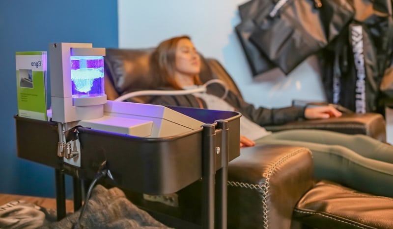 NanoVi Machine with woman receiving treatment